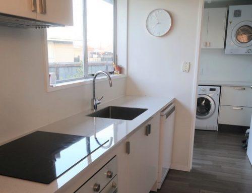 Sleek Splashback Completes Kitchen and Laundry Reno