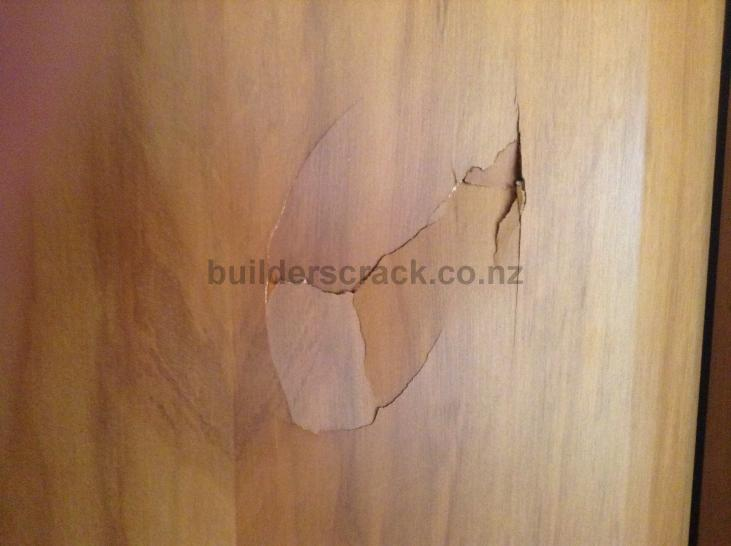 Wooden door hole repair. (# 41299) | Builderscrack