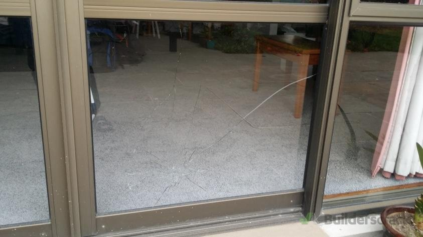 Broken Glass On Aluminium Sliding Door 299125 Builderscrack