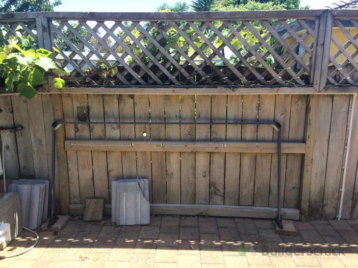 Install clothes line, bolts on outside gate (# 115732)   Builderscrack